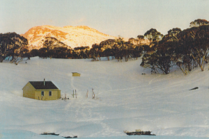 Photo John Purves. Dershkos Hut with Mt Jagungal background.