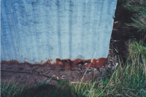 Rusty corrugated iron, since repaired, Photo Jerry Gregg 2002