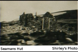 The only known photo of Seamans Hut being built.
