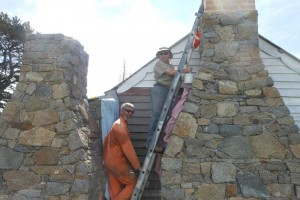 Bob Salijevic (then HMO Namadgi) and Simon Buckpitt (current) painting around chimney, photo John Allen Oct 2014.